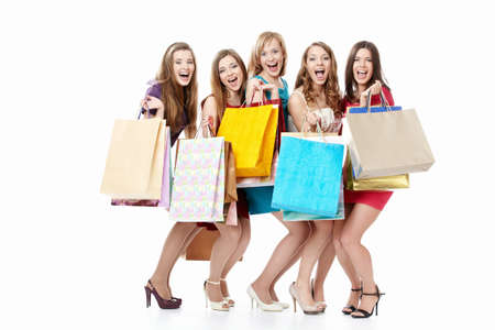 Screaming girls in dresses with shopping photo
