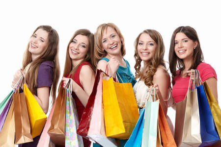 shopaholics: Smiling girl with a bag on a white background Stock Photo