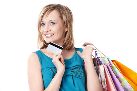 Girl with bags and credit card on a white background photo