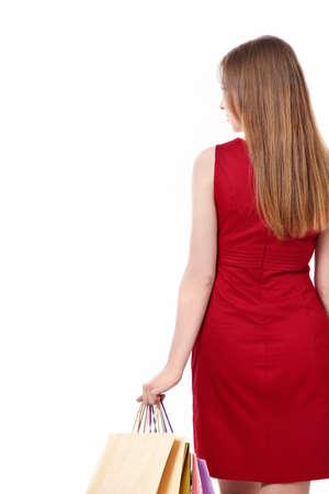 back of woman: La mujer con los paquetes sobre un fondo blanco