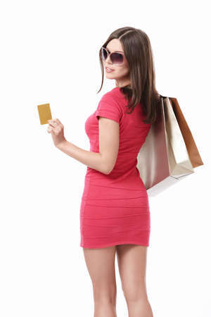 gastos: Girl with shopping bags and credit cards in sunglasses on white background