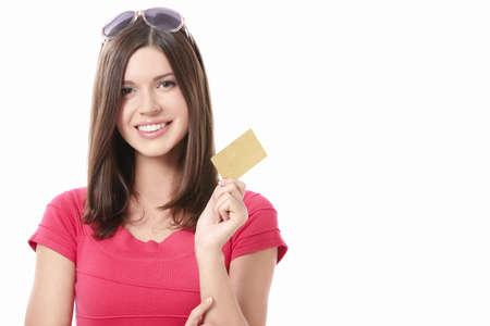 tarjeta de credito: Ni�a con bolsas y tarjeta de cr�dito en un fondo blanco Foto de archivo