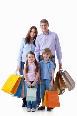 Family with shopping bags on a white background Stock Photo - 9602848