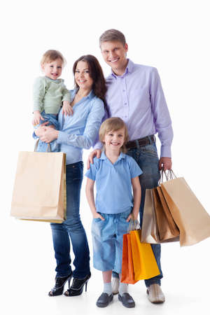 happy shopper: Family with shopping bags on a white background Stock Photo