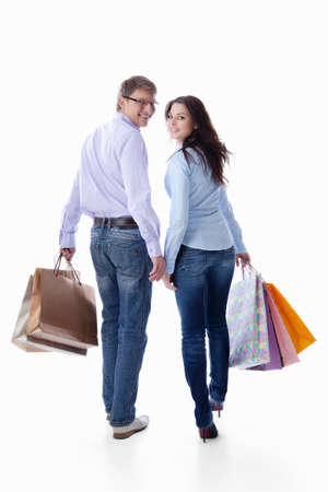 couple WALKING: Couple with bags on a white background Stock Photo