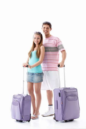 Attractive young couple with suitcases isolated Stock Photo - 9606469