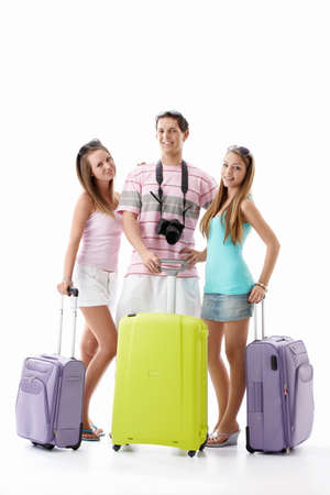 Young friends with suitcases on a white background photo