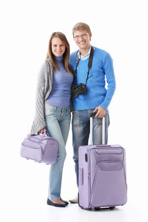 Attractive young couple with suitcases isolated photo