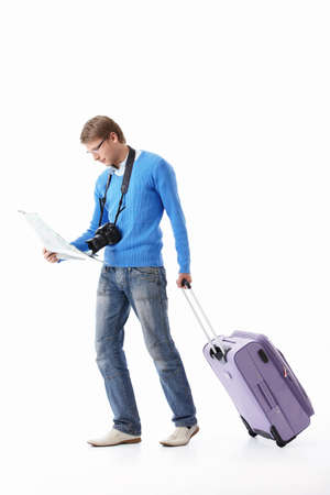 A young man with a suitcase on a white background Stock Photo - 9602783