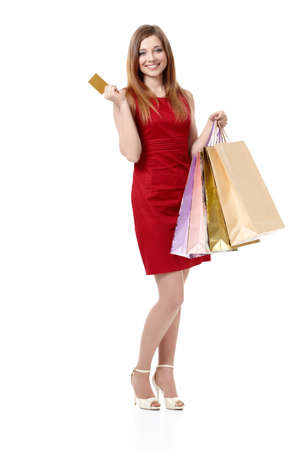 Beautiful girl with a credit card and shopping bags on white background Stock Photo - 9606211