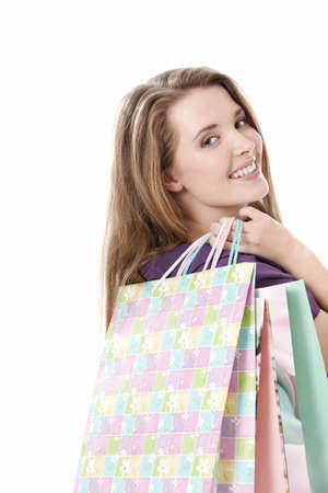 Young girl with shopping bags on white background photo