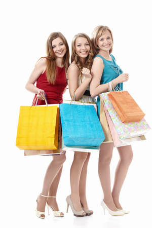 friends shopping: Attractive girls with bags on a white background