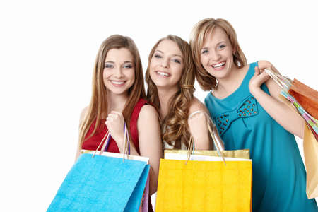 3 persons: Smiling girl with shopping bags on white background