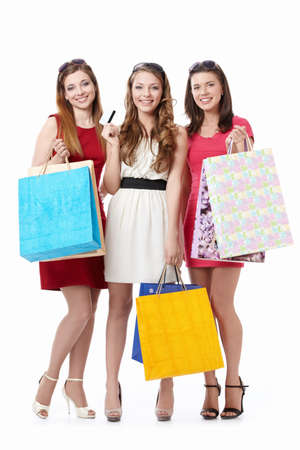Beautiful girl with shopping bags and credit card on a white background Stock Photo - 9603076