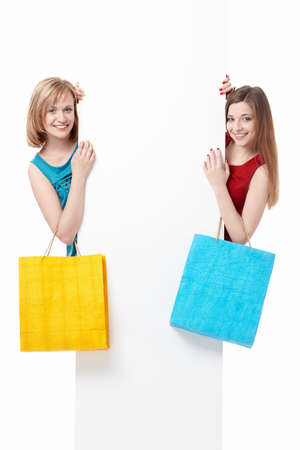 two girls: Beautiful girl with shopping bags and billboards
