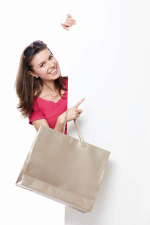 A young woman with a bag of points to advertise photo