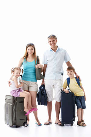 vacations: Family with luggage on white background Stock Photo