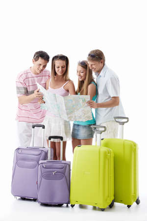 Friends with suitcases look the map on a white background photo
