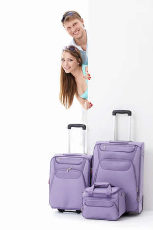 Couple with suitcases and billboards on a white background photo