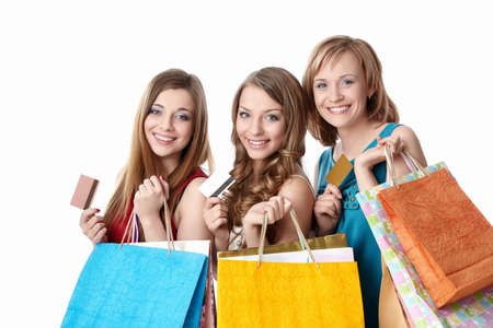 Beautiful girl with shopping bags and credit card on a white background photo