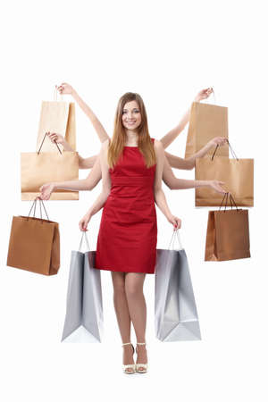 spending: Attractive many-armed woman with shopping bags on white background Stock Photo