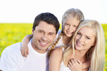Portrait of a happy family outdoors Stock Photo - 9695101