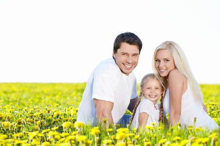 Smiling family in the lush field photo