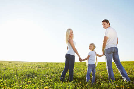 family holidays: Happy family in the lush field Stock Photo