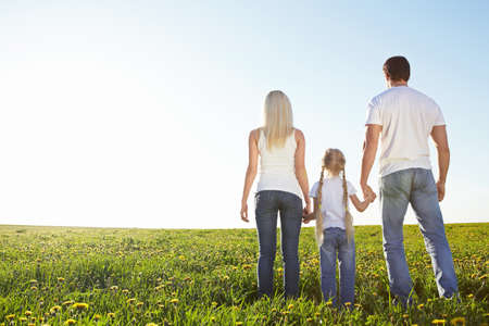 Family in the lush field Stock Photo - 9869093