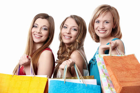 Three attractive young women with bag isolated photo