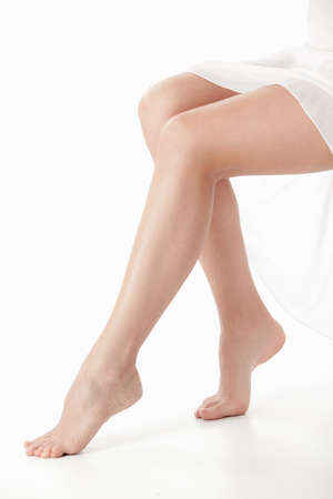 Beautiful young legs on a white background photo