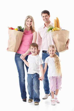 man and woman with shopping bags: A happy family with their purchases on a white background Stock Photo