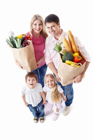 healthy person: A happy family with their purchases on a white background Stock Photo