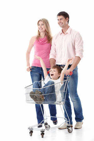 Young couple in a cart driven by his son on a white background Stock Photo - 9794415
