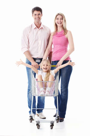 woman shopping cart: Young couple and daughter in a cart on a white background