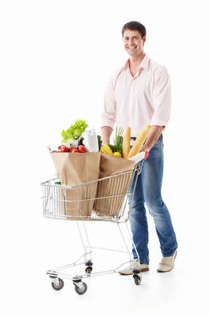 A young man with a cart with food on a white background Stock Photo - 9794375