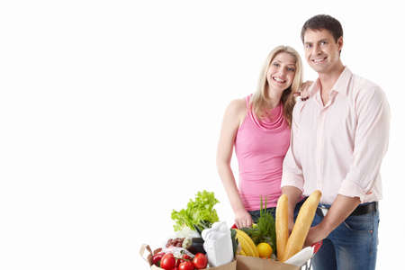 The happy couple with food on a white background Stock Photo - 9794371