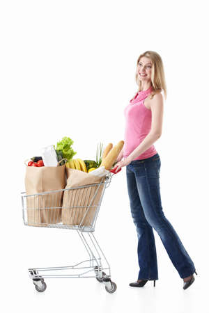 woman shopping cart: Happy girl with a cart with food on a white background