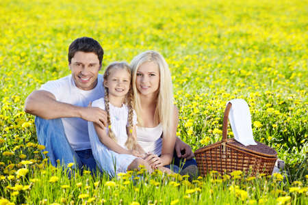 A happy family at a picnic in a field photo