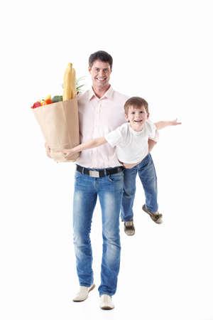 A man with a baby and a bag of food on a white background Stock Photo - 9794523