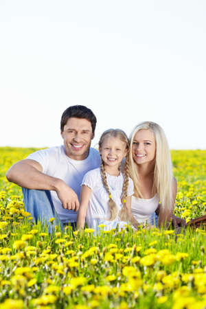 Young family with a child in field photo