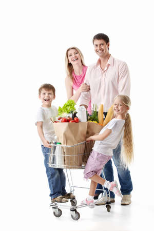 woman shopping cart: Family with cart with purchases isolated