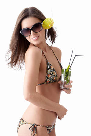 Young beautiful girl in sunglasses with a cocktail on a white background Stock Photo
