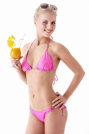 young girl bikini: A beautiful girl with a cocktail on a white background Stock Photo