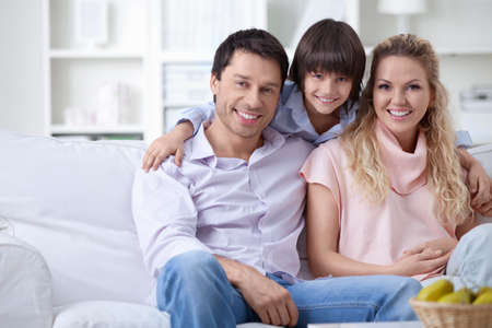 A happy family with a child at home Stock Photo - 9997061