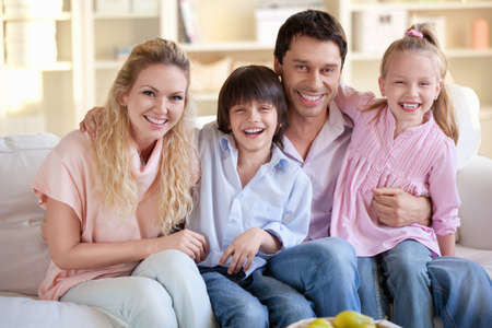 Laughing families with children at home photo