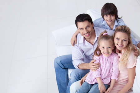 Happy family on the couch Stock Photo - 9997053