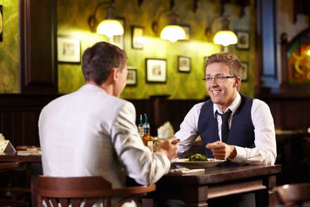 Two young men talking in the pub photo