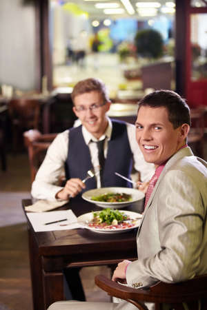 Two men having lunch in a restaurant Stock Photo - 9997051