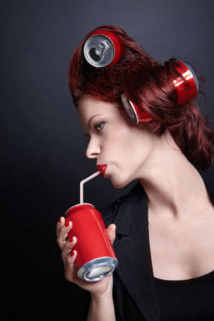 red straw: An attractive young woman drinking